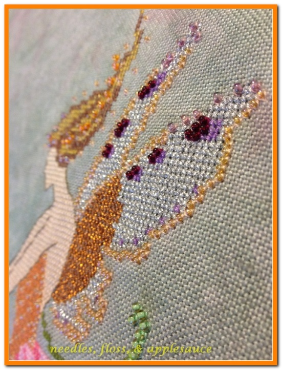 Angled view of beading on wings